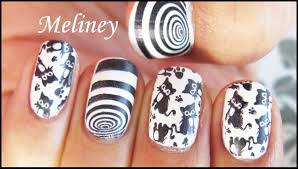 dizzy kitty stamping nail art design black cat vortex animal