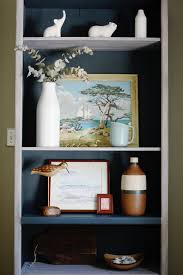 bookcase transformation painting and styling to create a cohesive