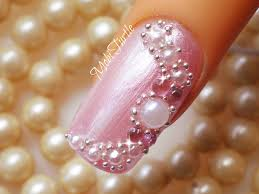 pink nails with golden beads and white pearls design nail art with