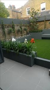 Modern Patio Design Modern Small Low Maintenance Garden Fake Grass Grey Raised Beds