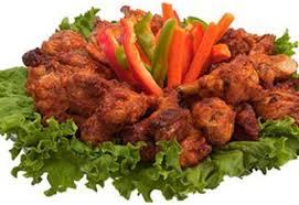 cuisiner des ailes de poulet ailes de poulet piquantes sauce à l ail coup de pouce