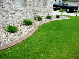 decor metal landscape edging with pebbles and green grass for