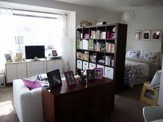 save space by putting the bed in a corner and use a bookcase as a
