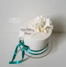 white and ivory roses birthday cake with teal ribbon by white rose