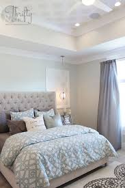 soothing paint colors of blue and grey for this master bedroom