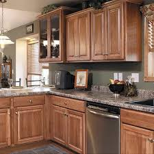hickory cabinets with granite countertops kitchen with granite countertops and hickory cabinets a kitchen