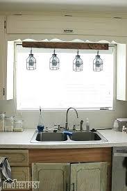 Kitchen Sink Lighting Ideas Kitchen Sink Lighting Multi Colored Tile Steel Appliances White