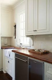 traditional off white kitchen with brick backsplash home bunch