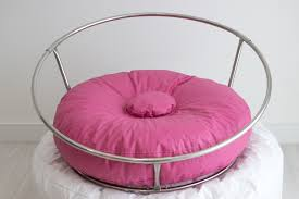 big stand with colored bean bag donut by paloma schell
