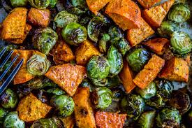 roasted sweet potatoes and brussels sprouts the food charlatan