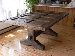distressed wood dining table with rustic reclaimed old door top