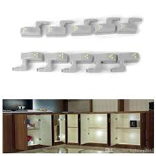 kitchen cabinet lighting canada led cabinet lights sensor l wardrobe cupboard door light 0 18w universal inner hinge auto switch bedroom kitchen lighting canada 2021 from