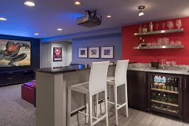 designer showcase basement home theater room with marvel wet bar