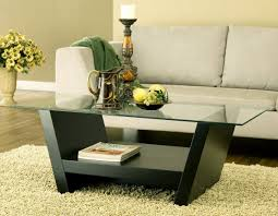 Under Sofa Tables by Glass Top Coffee Table In Square Shape And Wooden Legs The Glass