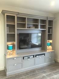 framed hand painted tv unit by enigma design home basements