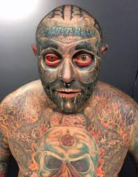 tattoo addict inks his and colours his eyeball red after