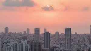 sunset over tel aviv skyline time lapse from day to night zoom