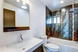 modern full bathroom with undermount sink u0026 rain shower head in