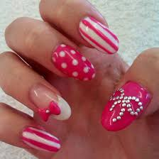 acrylic nails with bows are gellux the thumb bow is made of