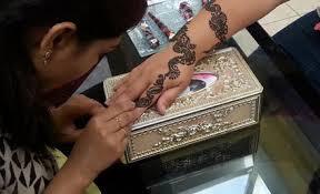 threading service or henna tattoos grabone