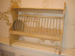 brown wooden wall mounted dish drying rack in a shabby chic design