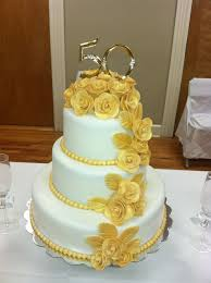 50th wedding anniversary cake roses are made gum paste
