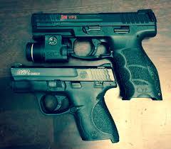 his and her 9mm pistols hk vp9 s u0026w m u0026p shield find our speedloader