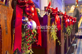 english church pews with christmas decoration stock photo thinkstock