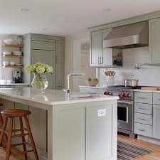 green kitchen cabinets with white countertops green kitchen cabinets design ideas