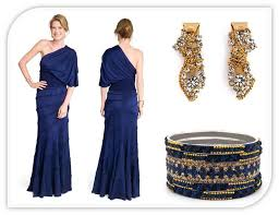 blue one shoulder full length bridesmaid dress and gold accessories