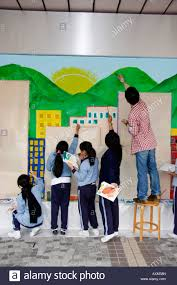 mural painting on school wall stock photos mural painting on hong kong school art class painting murals on a wall of the museum of modern art