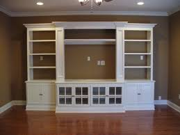 glass cabinet doors for entertainment center built in entertainment center using ikea hemne pieces 2 bookcases