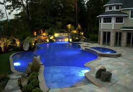 decorating awesome indoor swimming pool design idea with green