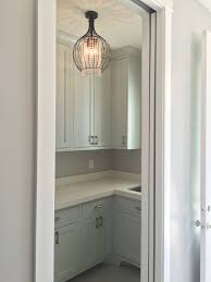 laundry room light and cabinets paint color is sherwin williams