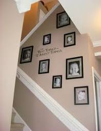 Excellent use of stairway space decorating use chair rail to