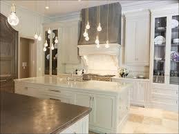 kitchen kitchen with white cabinets and black appliances dark