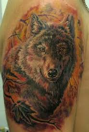 wolf on the background of autumn leaves wolf tattoos