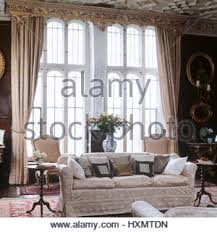 living room with pair of victorian style chairs on either side of