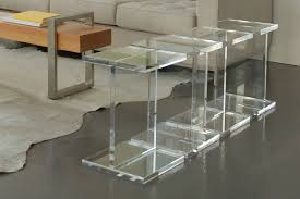 the power of lucite coffee table in garnishing living space room