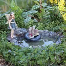 fairy swimming hole with faries miniature fairy garden ideas