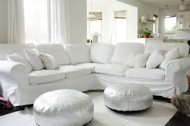 what39s not to love white slipcovered couch silver poufs white