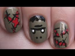 frankenstein nail art with bloody stitches halloween nail
