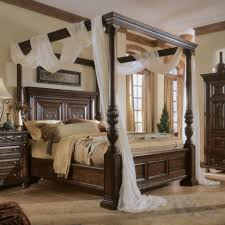 dark brown wooden canopy bed with four pole also long white