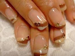 28 french nails with gold design states gold maroon and clear