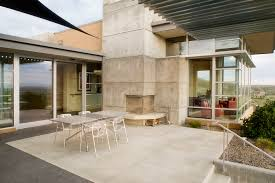 corner outdoor fireplace patio modern with concrete fireplace