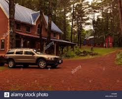 volvo canada brick country house or cottage and volvo xc70 station wagon car in