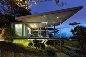glass house elevated on top of metallic columns has also 3 big