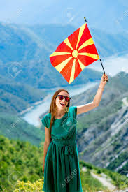 Macedonian Flag Young Happy Woman In Green Dress Holding Macedonian Flag On The