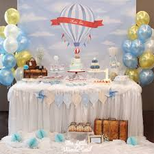 hot air balloon decorations dessert table from a vintage hot air balloon birthday party via