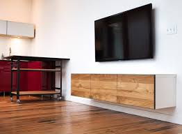white and brown wooden floating media console with three storages